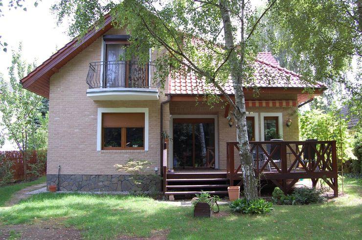 ITA Poland s.c. Rustic style house Bricks