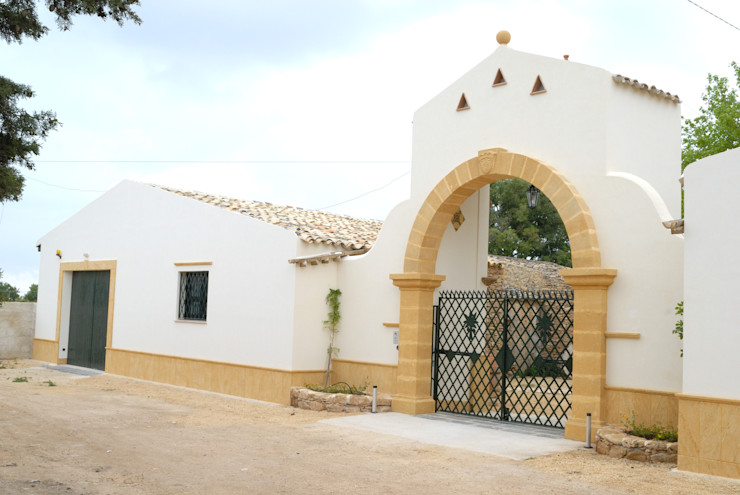 Arco in tufo Artigiantufo Ingresso, Corridoio & Scale in stile mediterraneo Arenaria Giallo