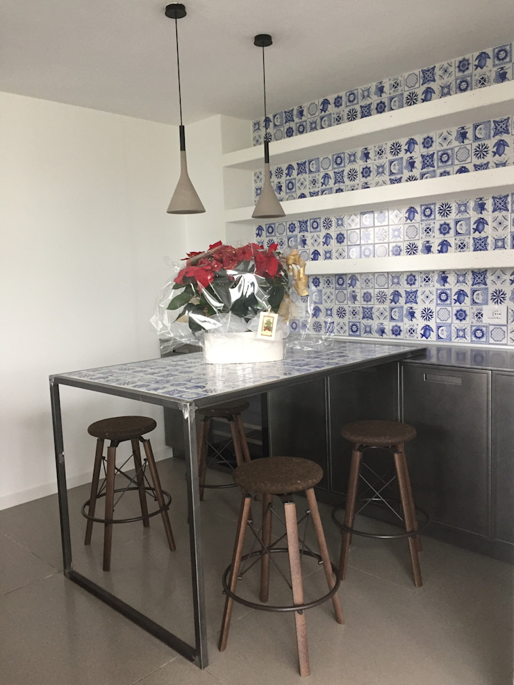 UNA ARCHITETTURA RIGOROSA HP Interior srl CucinaTavoli & Sedie