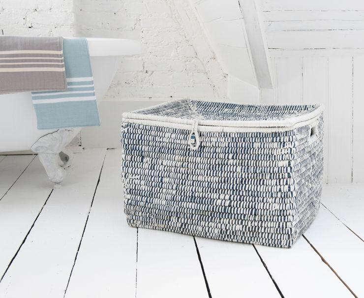 Tricks laundry basket homify BathroomStorage Wood-Plastic Composite Blue