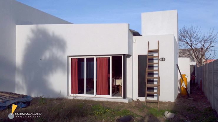 Patricio Galland Arquitectura Eclectic style houses