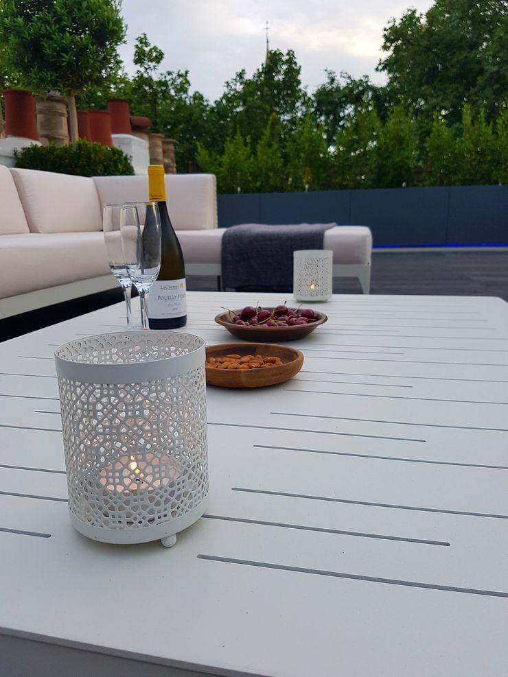 Ethimo furniture Paul Newman Landscapes Modern balcony, veranda & terrace