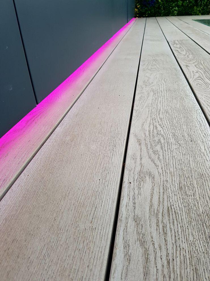 Enhanced grain Smoked Oak Millboard decking with LED lighting strip Paul Newman Landscapes Modern balcony, veranda & terrace