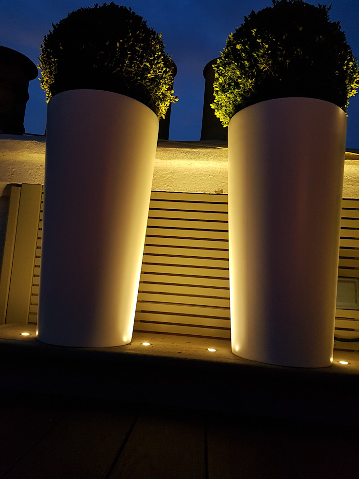 Tall cylindrical planters uplift with LED lighting Paul Newman Landscapes Modern balcony, veranda & terrace
