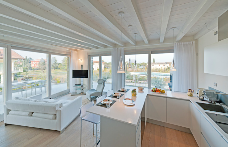 All White Apartment Gracious Luxury Interiors Modern kitchen White