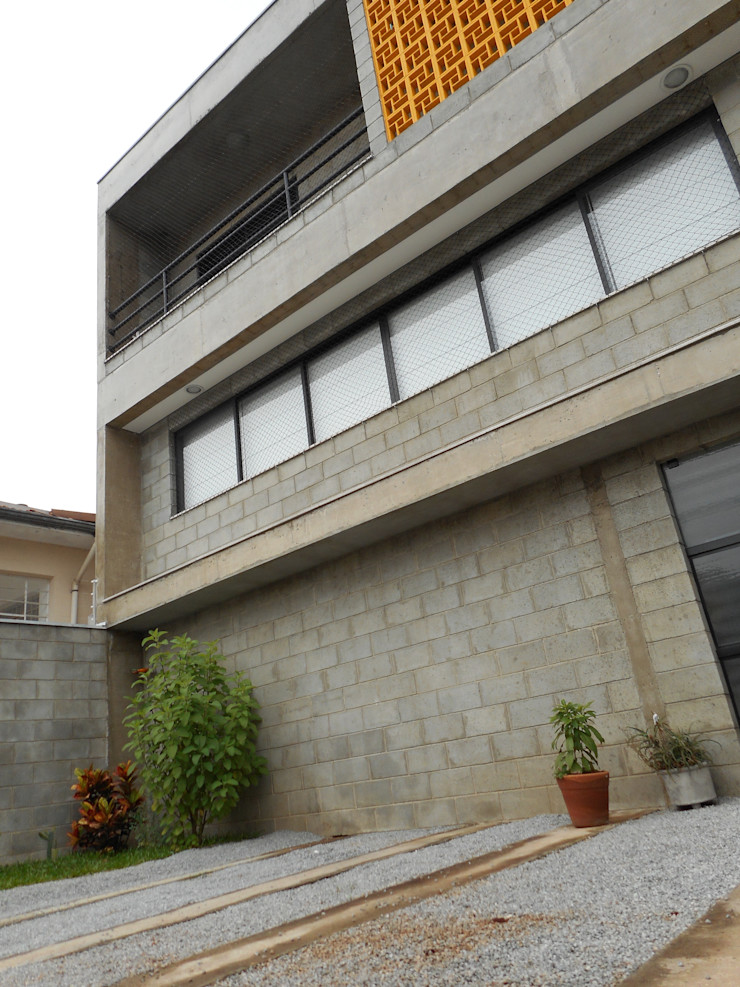 Metamorfose Arquitetura e Urbanismo Rustic style houses Concrete