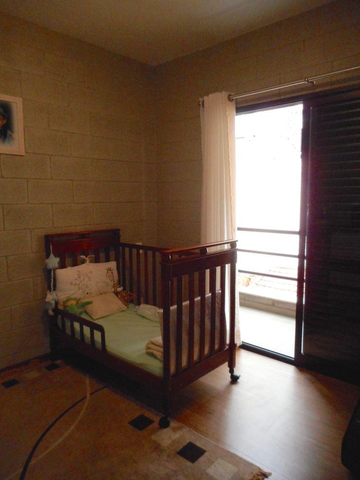 Metamorfose Arquitetura e Urbanismo Rustic style nursery/kids room