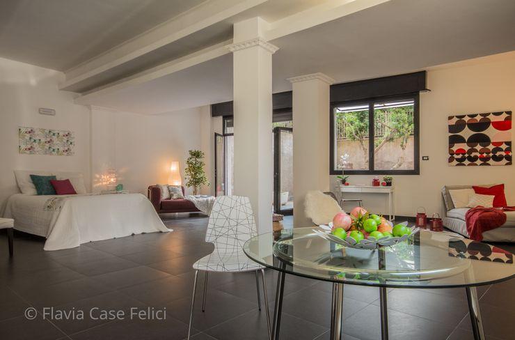 Flavia Case Felici Salones de estilo moderno