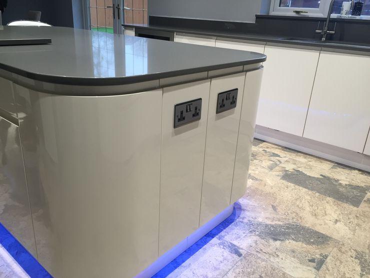 Kitchen Island with feature plinth lighting Meridien Interiors Ltd Modern kitchen