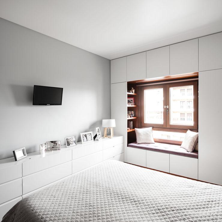 Estúdio AMATAM Dormitorios de estilo ecléctico
