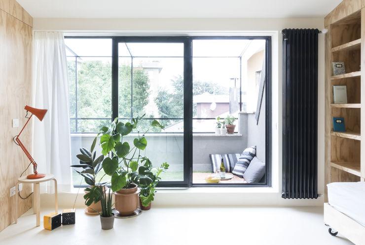 Batipin flat - studio wok studio wok Balcone, Veranda & Terrazza in stile moderno