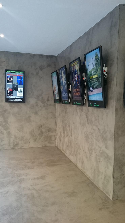 Suelo de microcemento en cine Texas, Barcelona FUTURCRET Paredes y pisos de estilo industrial