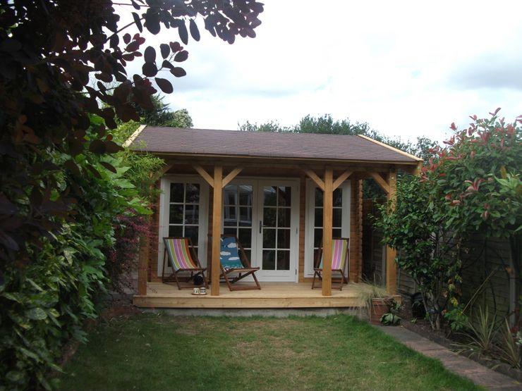 Scandinavian style log cabin. Garden Affairs Ltd Scandinavian style garden Wood Wood effect