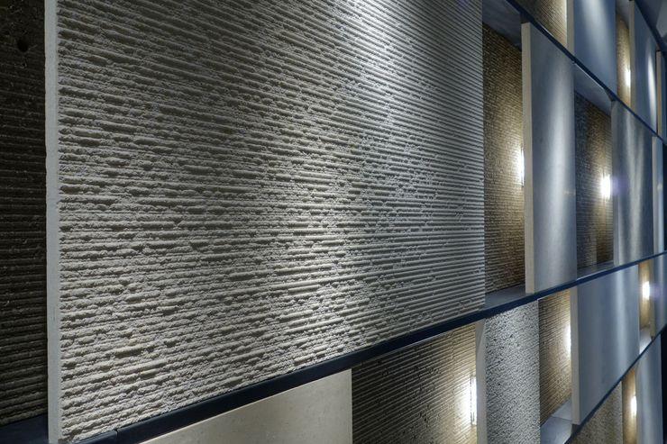 Grassi Pietre srl Tường & sàn phong cách hiện đại Cục đá Beige