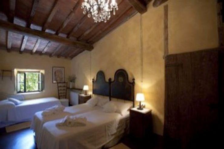 camera da letto b&b Studio Tecnico Progettisti Associati Ing. Marani Marco & Arch. Dei Claudia Camera da letto in stile classico