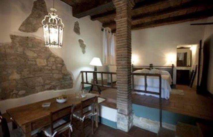 camera da letto b&b Studio Tecnico Progettisti Associati Ing. Marani Marco & Arch. Dei Claudia Soggiorno rurale