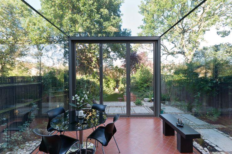 Frameless Glass Box Extension Trombe Ltd Modern dining room