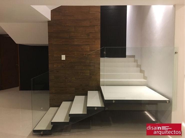 homify Modern corridor, hallway & stairs Metal Black