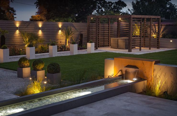 A contemporary industrial garden Robert Hughes Garden Design Garden Lighting