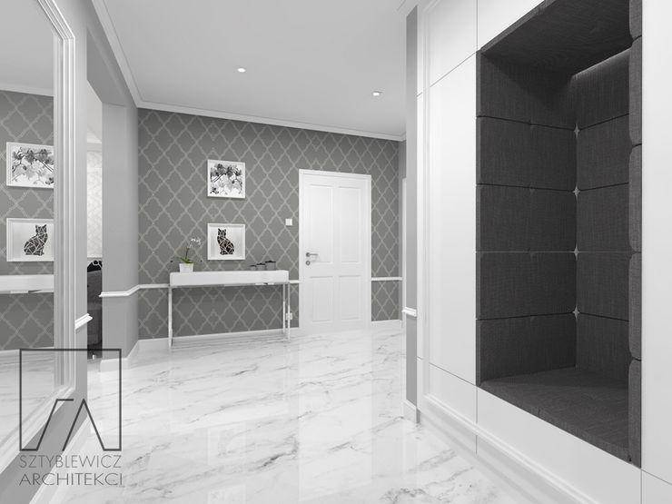 Mieszkanie w Poznaniu SZTYBLEWICZ ARCHITEKCI Klasyczny korytarz, przedpokój i schody Marmur Biały