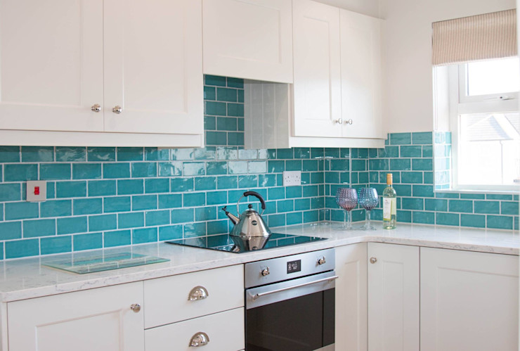 Vibrant Aqua tiles with Porcelain Cabinets ADORNAS KITCHENS Classic style kitchen Ceramic Beige