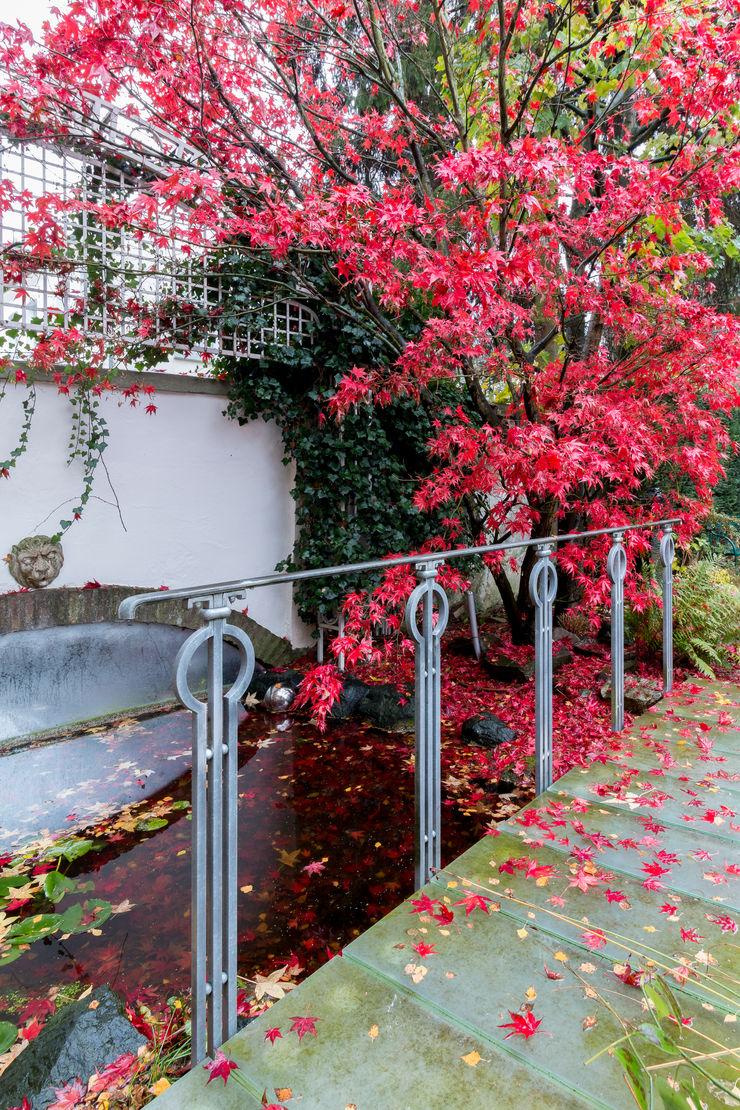 28 Grad Architektur GmbH Classic style garden