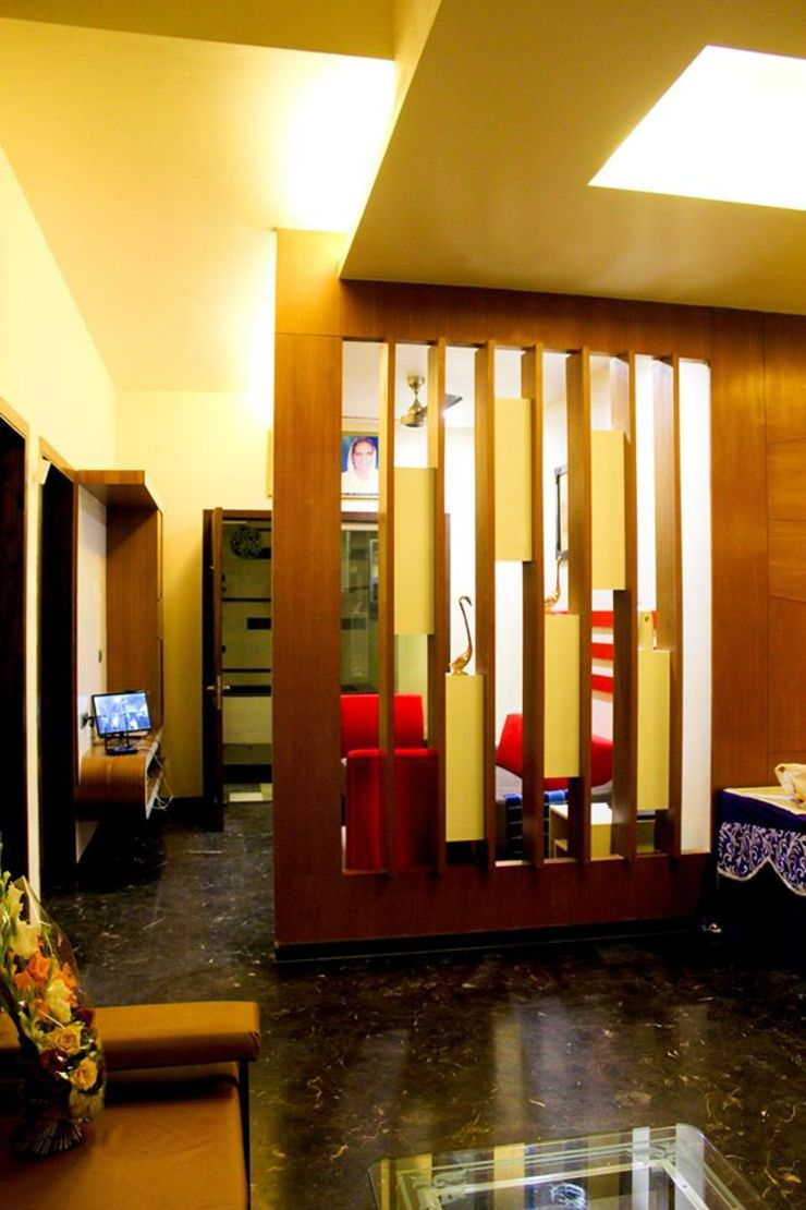 RESIDENCE : AMRITSAR TULI ARCHITECTS AND ENGINEERS Modern Living Room Engineered Wood Amber/Gold