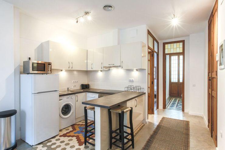Rimolo & Grosso, arquitectos Cocinas modernas Aglomerado Beige