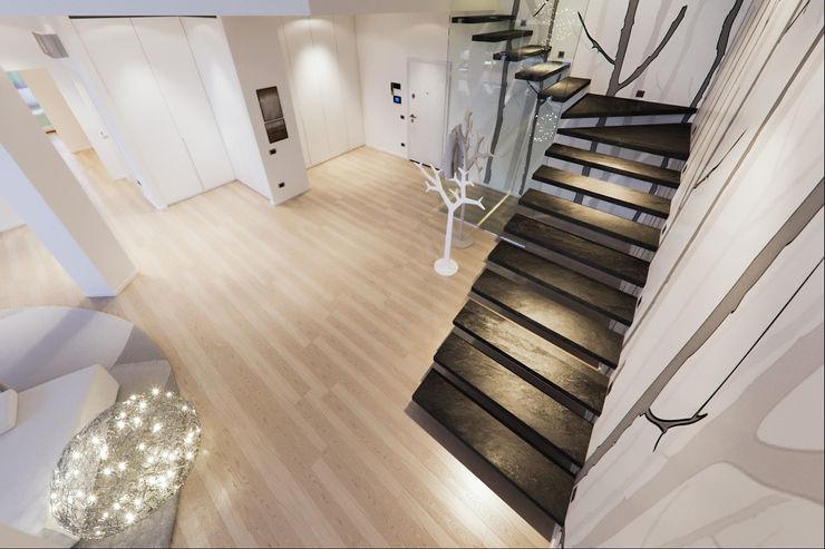 Un attico in stile loft in Milano Annalisa Carli Ingresso, Corridoio & Scale in stile moderno Legno massello Bianco