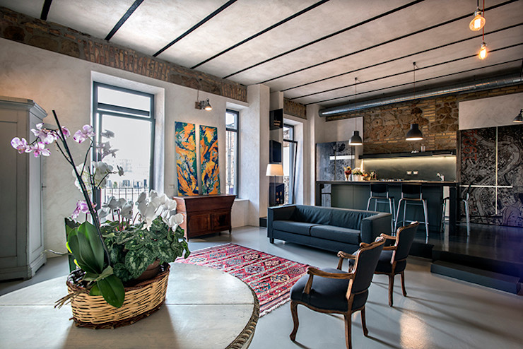 Quartiere Ostiense: una casa dal sapore Industriale studioQ Soggiorno in stile industriale
