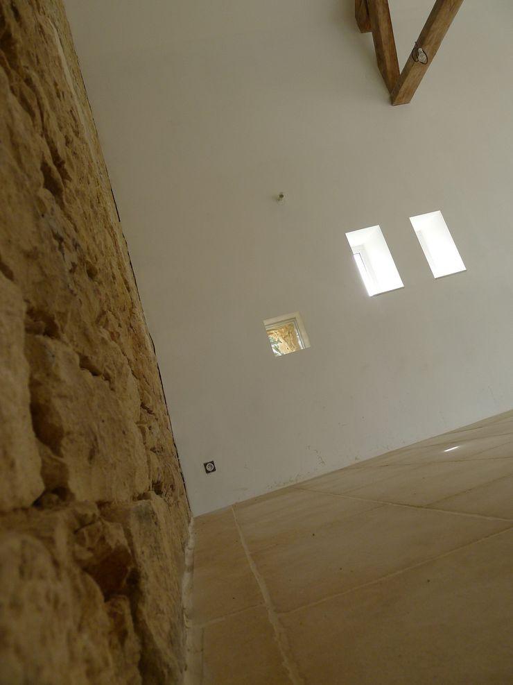 Longère de Saint Appo | Vue 02 Vincent Athias Architecte DPLG Salon rural Pierre Beige