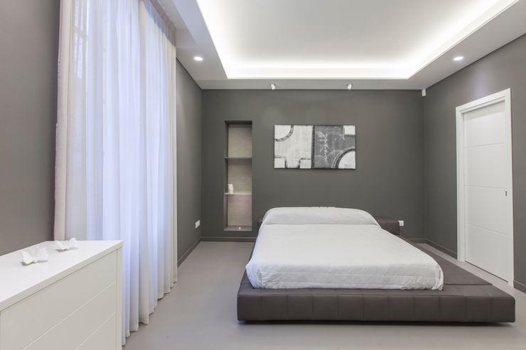 camera da letto Resin srl Pareti & Pavimenti in stile moderno