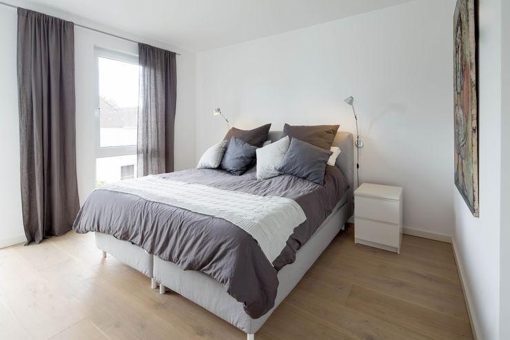 Ferreira | Verfürth Architekten Habitaciones modernas