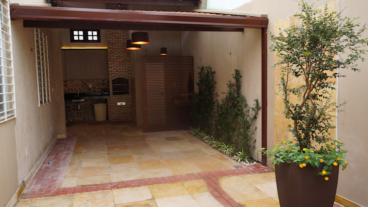 Reinaldo Pampolha Arquitetura Rustic style garage/shed