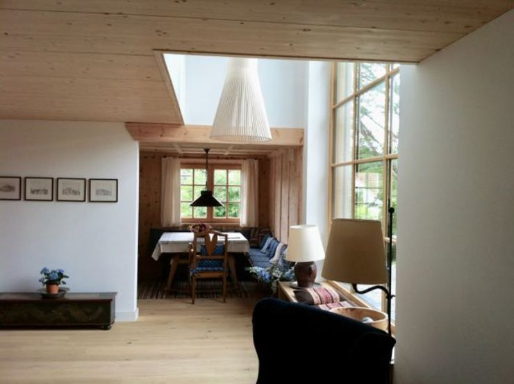w. raum Architektur + Innenarchitektur Livings de estilo