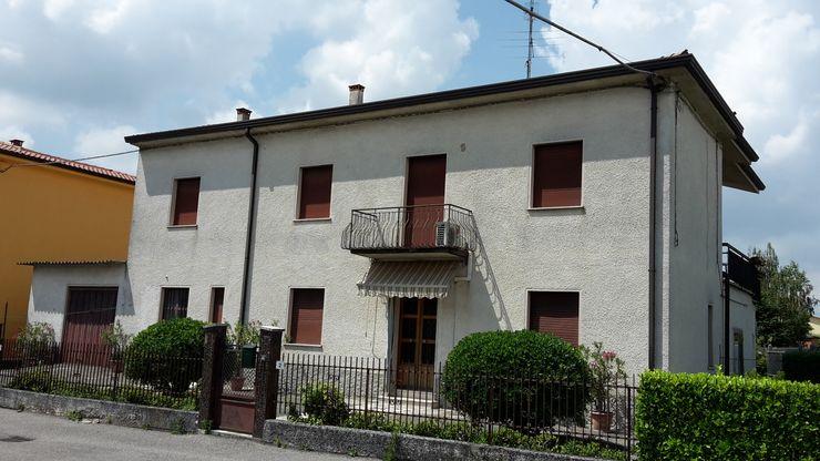 PRIMA... Adami|Zeni Ingegneria e Architettura Case in stile rustico Laterizio Grigio