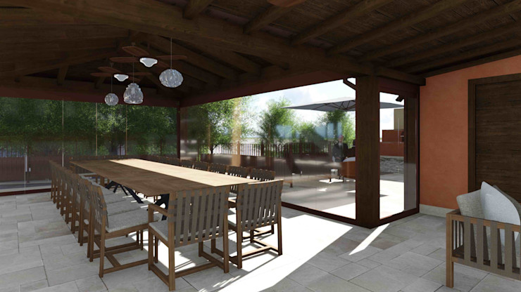 The dining area in the wooden gazebo closed by folding windows Planet G Giardino d'inverno in stile mediterraneo