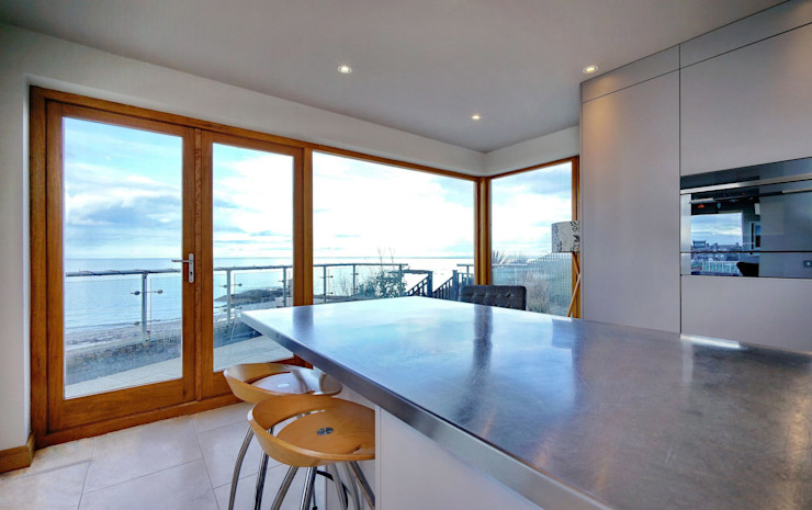 Stainless Steel Worktops reflect the changing outside environment ADORNAS KITCHENS Modern kitchen Wood Brown