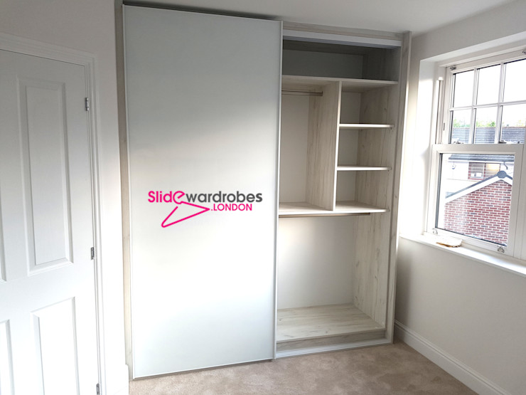 Floor to ceiling wardrobe with 2 sliding doors. Opened door view Slide Wardrobes London BedroomWardrobes & closets Glass White