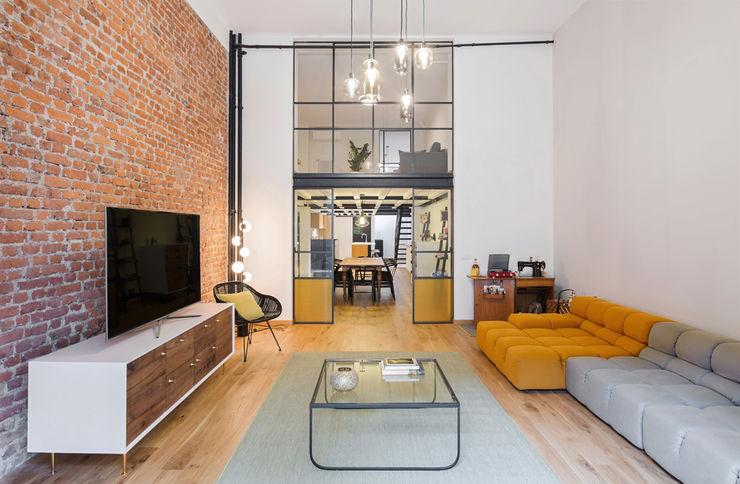 NOMADE ARCHITETTURA E INTERIOR DESIGN Salas de estilo industrial