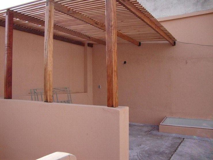 ARQUITECTA MORIELLO Balkon, Beranda & Teras Modern