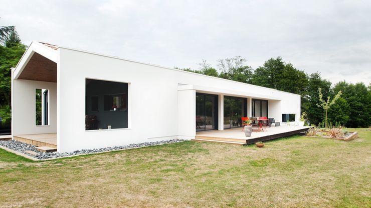 Plus Architectes Modern Houses
