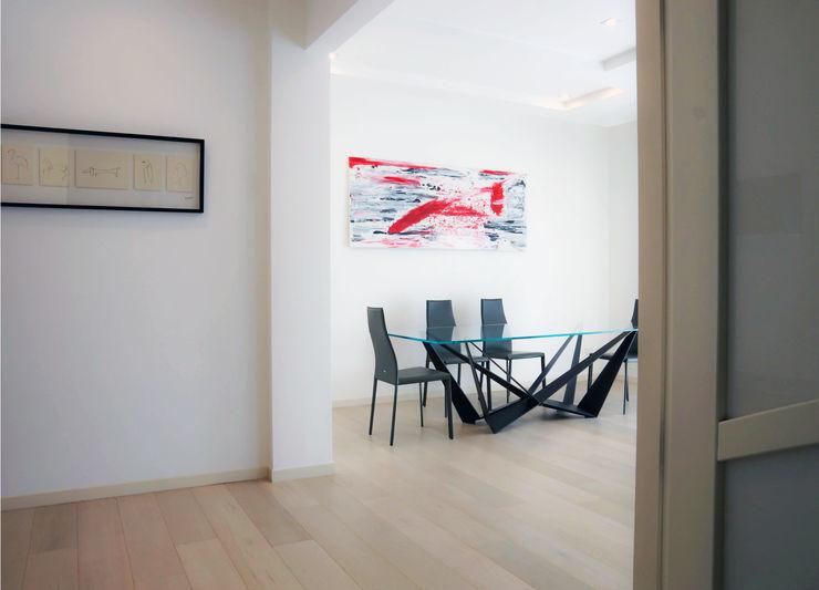 Polihouse Luca Bucciantini Architettura d' interni Soggiorno minimalista Legno Rosso