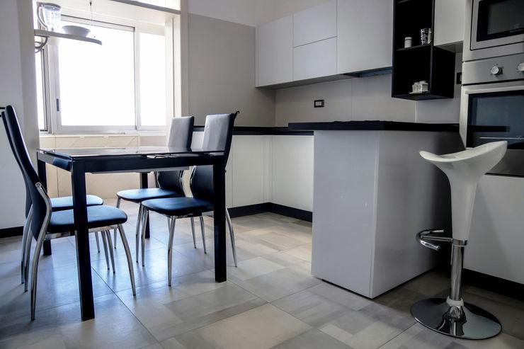 Polihouse Luca Bucciantini Architettura d' interni Cucina minimalista Legno Bianco