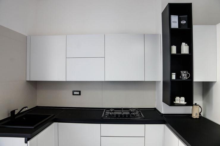 Polihouse Luca Bucciantini Architettura d' interni Cucina minimalista Legno Nero
