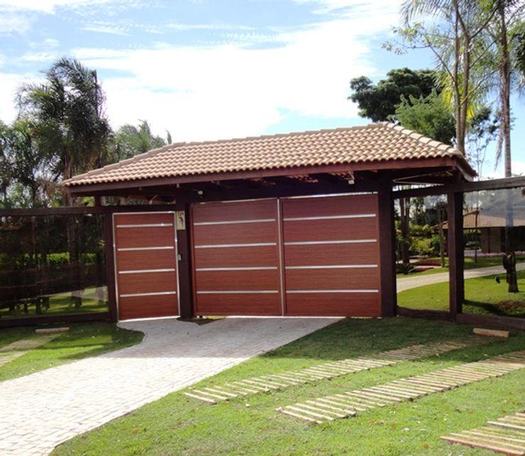 Guilherme Elias Arquiteto Casas de estilo rural Aluminio/Cinc Acabado en madera