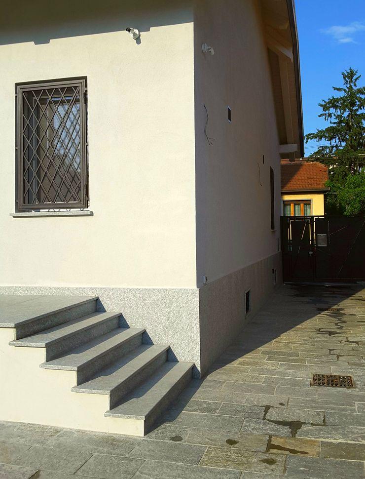 Casa Savada ArchitetturaTerapia® Case moderne Pietra Grigio