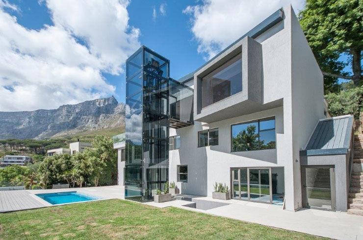 Road side elevation. Architectural Hub Modern houses Bricks Grey