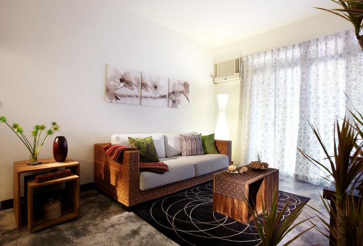 藤編沙發搭配柚木實木木箱,既可坐又可放,增添空間的隨意感 弘悅國際室內裝修有限公司 客廳 實木 Wood effect
