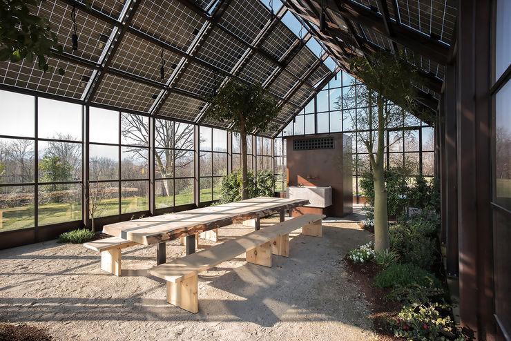 hillside house zanon architetti associati Country style conservatory
